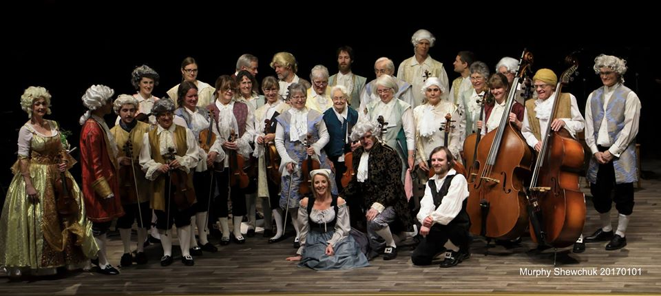 the members of the kamloops brandenburg orchestra posing in period Baroque costume