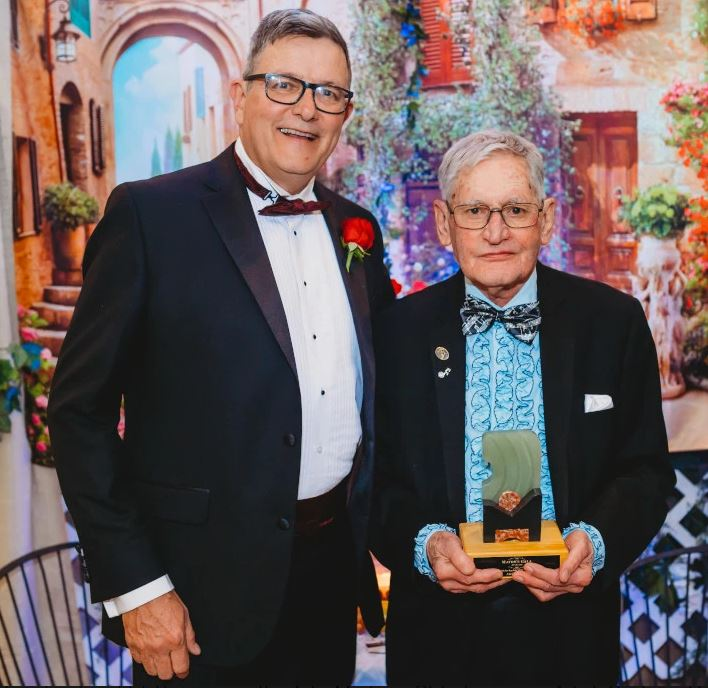 Kamloops Mayor Christian present Michael Powell with Enduring Supporter Award